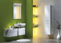 green paint for wall and bathroom shelves, white storage cabinets and
