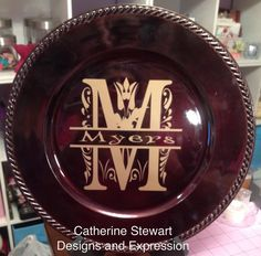 Here is one of the several charger plates I monogramed. Vinyl cut with cricut explore.