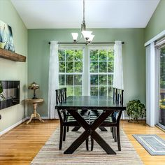 Bright dining room with easy access to the backyard. We love the vaulted ceiling, hardwood flooring, modern light fixture and windows. Listed in Lovettsville, Virginia by The Casey Samson Team is a Wall Street Journal Top Team in Northern Virginia.