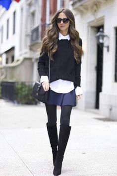 White blouse. Black pullover. Blue skirt. Black tights. High boots.