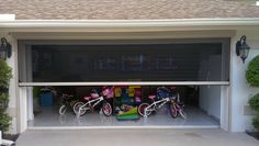 motorized garage screens essential for any bug free man cave