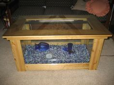 Aquarium coffee table plans This fish tank coffee table is a crowd pleasure Build an aquarium coffee table for a fraction of the cost of ready made models Fish Tank Table, Fish Tank Coffee Table, Made Coffee Table, Coffee Table Plans, Glass Top Coffee Table, Coffee Table Design, Diy Aquarium, Aquarium Design, Aquarium Fish Tank