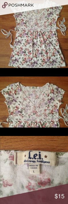 L.E.I Floral and Lace Blouse Beautiful light floral background with lace detailing and lace tie back. Very shabby chic. Junior L. lei Tops Blouses
