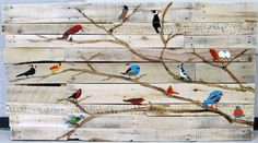 Reclaimed wood and features birds painted by third graders. Perfect for an art auction.
