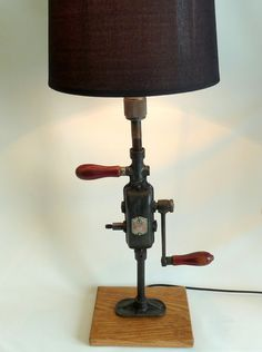 This is a striking vintage hand drill lamp . The lamp is a beautiful example of the products of that era,1930's. one of the best drills of his time ,