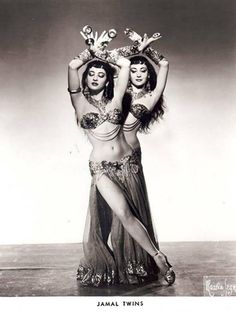 bellydanceclassics:  A stunning photograph of Egyptian dancers Lys and Lyn Gamal.