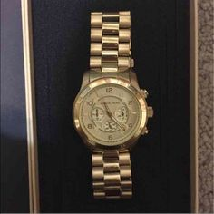 Michael Kors Runway Oversized Gold watch Michael Kors Runway oversized gold-tone stainless steel watch  Store style #: MK8077 -oversized watch -push clasp -water resistant up to 5 atm -tells day/time -stopwatch as well  -extra clasps included  Like new only worn at most 3 times. No scratches on face of watch. Some small scratches on clasps not very noticeable.                       Open to offers!! Michael Kors Accessories Watches