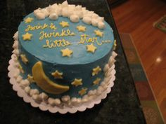 Twinkle, twinkle, little star . . . - White cake with white buttercream filling. Iced with buttercream, fondant stars and moons. The cake was topped with 2 cherubs laying on top of the clouds.