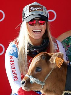 Winner Lara Gut of Switzerland with a veal during the podium ceremony of the Women's Downhill race at the FIS Alpine Skiing World Cup in Val d'Isere, France.