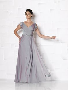 Two-toned chiffon A-line dress with split flutter short sleeves, front and back V-necklines, crisscross gathered bodice accented with hand-beaded waistline, side draped skirt. Sizes:4 – 20, 16W – 26W, 16WP – 26WP