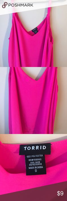 Torrid Tank Top Torrid tank top Size 0 in torrid clothing  Bright Pink color with adjustable straps and a under layer  Gently used but please note, all used pieces in my closet can potentially have very minor loose threads. torrid Tops Tank Tops