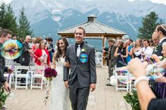 Smiles and bubbles for the recessional during this beauty Canmore Silvertip Resort Wedding - Canadian Rockies Weddings See more from their celebration on the blog: http://blog.one-edition.ca/silvertip-wedding-photographer-robyn-nate/