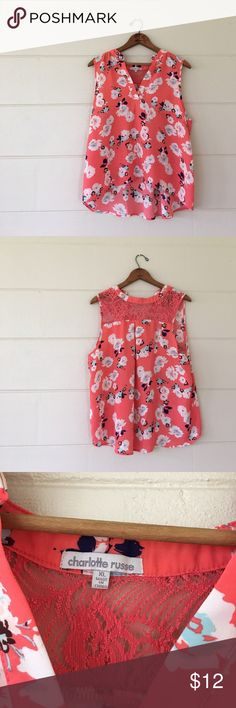 Charlotte Russe floral tank top Charlotte Russe brand floral tank top size xlarge. Bust is 46 inches length min front is 21 inches length in back is 25 inches sleeve width is 4 inches. 100% polyester. In excellent condition Charlotte Russe Tops Tank Tops