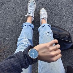 Match a pair of boyfriend jeans with white Converse and a minimal watch and…