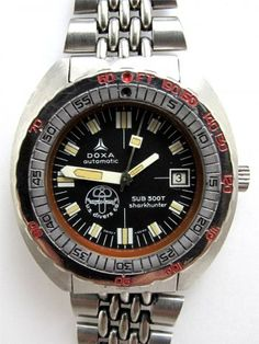 Doxa 300T Sharkhunter US Divers Co.  Got this same watch on my wrist right now.