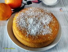 TORTA SOFFICE ALL'ARANCIA SENZA BURRO E LATTE,un dolce soffice e morbidissimo una ricetta senza burro e latte.Una ricetta semplicissima l'impasto