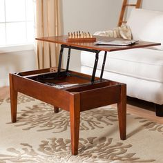 Turner Lift Top Coffee Table - Oak - How do you keep your room so clean and organized? Surprise: the books, magazines, pens, and games can be tucked inside the Turner Lift Top...