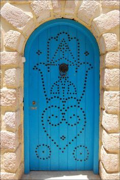 Protected door with the hand of God.  author photo unknown