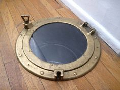 Brass porthole cover for a laundry chute!
