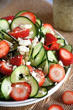 A refreshing and crisp strawberry poppyseed salad with spiralized cucumbers and feta salad all topped with a fruity poppyseed dressing!
