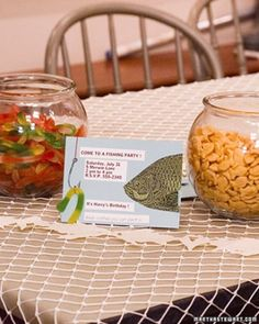 A Fishy Tablescape - Fishbowls filled with gummy worms, gummy fish, or fish-shaped crackers, lay netting over the table, and last but not least, fill a fishing-tackle box with assorted candies and use it as a centerpiece.