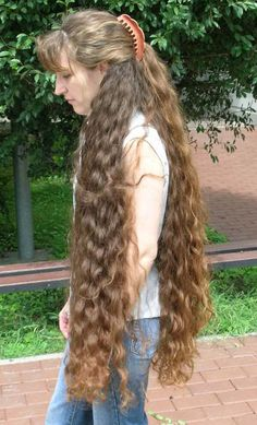 a cascade of thick, classic-length curls