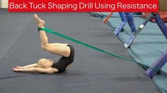 Back Tuck Shaping Using Resistance Athletes need to maintain correct shaping during the flight of a back tuck for the most efficient rotation. When learning . Gymnastics At Home, Gymnastics Lessons, Gymnastics Routines, Preschool Gymnastics, Gymnastics Floor, Gymnastics Tricks, Gymnastics Coaching, Acrobatic Gymnastics, Gymnastics Workout