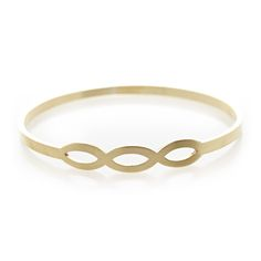 Dear Rae Jewellery | Tryptic pod brass bangle. A thin flat brass bangle with a centered tryptic of pod shapes.