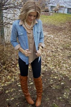 light blue denim collared button up, stripped collared button up underneath, black leggings, and tall brown leather boots.