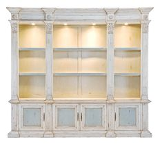 A superb and substantial Classical Library book case in solid walnut with graduated shelves flanked by stylized Corinthian columns and leading to 'panelled' cupboards below, decorated through- out in antique Venetian ivory and fitted with glass shelves and backlighting. Via Dovecote Decor