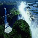 The Victoria Falls is a beautiful waterfall that is on the border of Zambia and Zimbabwe in Africa. The waterfall is 355 feet. There is even something called the Devil's Pool that allows you to play on the edge of Victoria Falls. Beautiful Places To Visit, Cool Places To Visit, Places To Travel, Chutes Victoria, 7 Natural Wonders, Largest Waterfall, Les Cascades, Garden Route, Beautiful Waterfalls