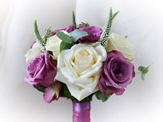 Lilacs and creams blue curiosa roses, avalanche roses, and verconica