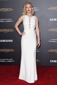 Jennifer Lawrence wearing  Repossi White Noise Cuff Bracelet, Dior Scalloped Gown
