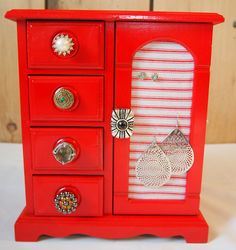 Painted jewelry box with earring  knobs. -- like the door covered with fabric for earrings!