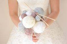Wool Ball Bouquet. A fun wool bouquet of wool balls adorned with wooden knitting needles, a ribbon handle and a large bow.  www.runwildbouquets.co.uk #WoolBouquet #AlternativeWedding #UniqueWedding