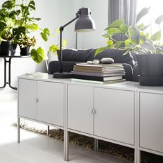 Get a head start on spring tidying with smart storage. A LIXHULT behind the sofa lets you tuck things neatly away, or keep them within arms reach.