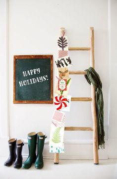 In this Tudor home, an old orchard staple becomes a fruitful holiday display with season's greetings (secured with clothespins attached to a string) along one side.