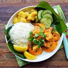 banana leaf sticky rice , mango , cucumber, lemon , tiger prawns and curry sauce = vegetarian dish