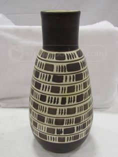 Vintage Italian Art Pottery Vase found on Goodwill.com.  No attribution, but the design looks very much like Bitossi.