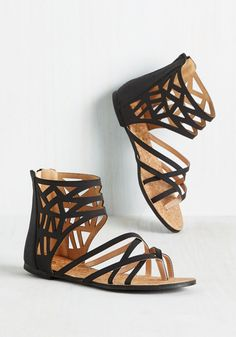 Make a motion to hit up the ocean in these vegan faux-leather sandals! Each lively move you make will feel like you're groovin', thanks to this black pair's edgy cutouts, crisscrossing straps, and cork footbeds. Now, go cut a rug on the boardwalk, girl!