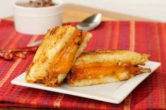 Grilled Cheese and Chili Sandwich  Yield: Serves 2 Ingredients:  4 slices of your favorite Sandwich Bread 6 ounces of sliced Sharp Cheddar Cheese 3 tablespoons Butter 1 cup of Chili Directions: