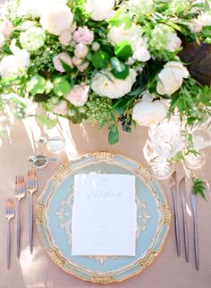 Blue and gold wedding place setting for Garden wedding reception