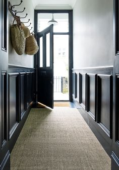 hallway with dark walls and natural seagrass carpet   The Best Place To Buy Designer Carpets At Budget Prices - WeLoveHome - Home Hallway Colour Schemes, Hallway Paint Colors, Grey Paint Colours, Color Schemes, Tiled Hallway, Dark Hallway, Long Hallway, Narrow Hallway Decorating, Victorian Hallway