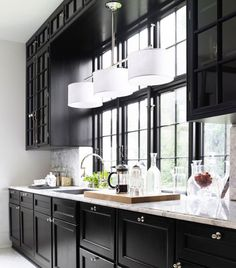 Dark black cabinets with gray tones in walls