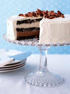 Ice cream cake: cookie layers made of oreos, chocolate chips and pecans between layers of chocolate and vanilla ice creams all frosted in whipped cream