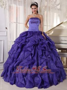 Low Prince Purple Quinceanera Dress Strapless Satin and Organza Beading Ball Gown  http://www.fashionos.com  http://www.facebook.com/quinceaneradress.fashionos.us  Gasps of awe will ensue when you sweep into the room in this flamboyant ball gown!Tiny, twinkling accents form edging along the strapless neckline of the surplice bodice.They also crowd along the dropped waistline. Wavy ruffles run down the length of the boldly flared, floor-brushing skirt.