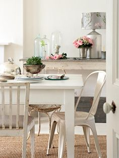 kitchen vignette, chair mix, distressed white-painted furniture, pop of pink and silver