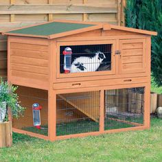 This two-story hutch with peaked roof is ideal for small animals. Pets can roam inside and outside, upstairs and downstairs, in the sun or in the shade while feeling safe and secure.  Wouldn't this be perfect for a small dog?  Just picture it.