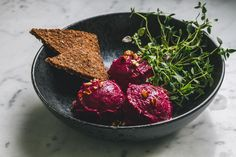BEET MOUSSE'Make art with your food and enjoy doing it' (Serves 4) To serve: * Fresh herbs or salad * Slices of bread * 6-7 small/medium beets * 4-5 avocados * 6-7 cauliflower florets * 1 small red onion * 1 lime (juice) * 1 cup unsalted pecan nuts * Fresh coriander leaves (two healthy handful) * Fresh basil leaves (two healthy handful) * 4 tbsp olive oil * 1 tsp mustard seeds * 1 tsp tamari sauce (optional) * Sea salt & black pepper...