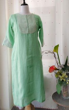 Pastel Green Pure Linen Kurta Crochet lace detailing on yoke and sleeves Potli buttons detailing at centre Straight fit with side slits Salwar Neck Designs, Kurta Neck Design, Neck Designs For Suits, Kurta Designs Women, Dress Neck Designs, Blouse Designs, Neckline Designs, Stylish Dress Designs, Designs For Dresses